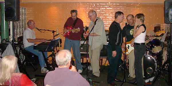 musicians on stage at the American Alehouse